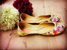 Sunshine floral juttis from the house of vian.. Love the flowers on the vibrant yellow base..