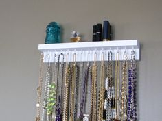 Necklace organizer - DIY or Etsy-  Literally two pieces of wood nailed together. Someone could attach frame hooks to the back for 25 cents. The hooks themselves could be nails of hooks found at walmart or home depot. Ta-da. Love the simplicity.