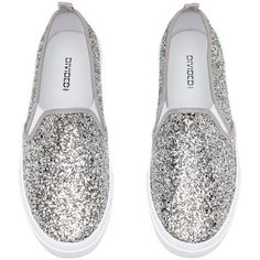 Silver-coloured. Glittery slip-on trainers with elastic gores in the sides and a loop at the back. Canvas linings and insoles and rubber soles
