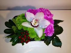Orchid + spray mums + carnations - Lilia Basulto