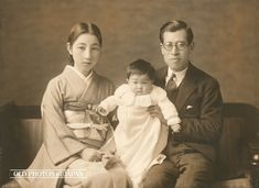 1910's. Husband, Wife and Baby. Ceremonial Taisho era photo of a family in formal wear for family members' fiftieth wedding anniversary (金婚記念, kinkon kinen). This photo comes from an album with 9 photographs. The accordion type album is covered in beautiful green textile stamped with golden characters that read kinkon kinen.