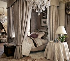 This canopy bed creates a more opulent and romantic feel. The monochromatic room is adorned with luxurious fabrics and a dazzling crystal chandelier.