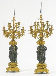 A large pair of Napoléon III gilt and patinated bronze twelve-light candelabras Paris, third quarter 19th century  
