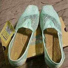 TOMS light blue lace rope flats New in box and with tags, beautiful lace blue Tom's. Perfect for summer and the new trend for brides and bridesmaids! Would also fit a size 10-10.5 foot TOMS Shoes Flats & Loafers