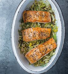 Salmon with Leeks, Fennel and Lemon | Baking salmon on top of leeks and fennel is an easy method for preparing the flavorful fish, and it takes less time than cooking all the components separately.