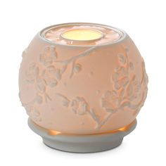 Cherry Blossom Warmer - Cherry blossom patterned bisque porcelain warmer to use with scented oil for continual fragrance and a tealight for a soft glow. reg $20 today only $4. Scented oil and tealight($5 sale going on now!) sold separately.  Enter my name as host to get this deal!