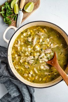 Cozy green chile chicken pozole made with hominy, veggies and wonderful herbs and spices. This delicious take on traditional chicken pozole is packed with protein and the perfect dinner for chilly months. Add your favorite toppings like shredded cabbage, greek yogurt and creamy avocado! #pozole #chicken #chickensoup #souprecipe #mexicanfood #healthydinner #glutenfree #healthylunch