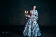 Woman in victorian dress - Woman in victorian dress imprisoned in a dungeon
