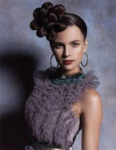 Love this, but on the side and NOT on top of your head!!! LOL. Side flower bun hair
