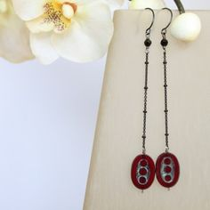 Matching Black Cherry Drop Earrings to the necklace! They are made of black cherry Picasso Czech glass beads suspended from a delicate black chain. The French earhook are made with Gunmetal..