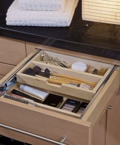 Storage solutions for make up built in vanity in master bathroom