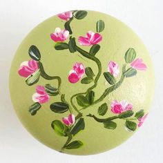 To get the fresh look of this pull, paint a wooden knob with small leaves and three-stroke flowers, using acrylic crafts paint.