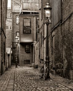 Cobblestone and brick alley in Boston...love the bike and the old gas lamp posts