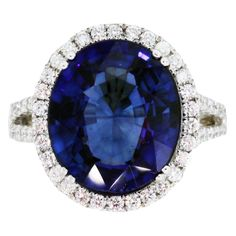 "8 Carat Sapphire Diamond White Gold Ring  Beautiful Oval Cut Blue Sapphire Measuring 14 x 12mm, 8.35ct. Set in a Micro-Pave Diamond Halo Setting. Approximately 1ctw of diamonds, G/H in color VS in clarity. Ring Measures 5/8"" long and 5/16"" wide on top. Size 6.75 (can be sized)  Price  $15,995 ★★★★★"
