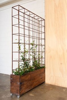 create a living wall this season: Build a rolling planter. Build a basic rectangle planter, put it on casters, and attach a simple-grid trellis. Design via Bangs Boutique #livingwall