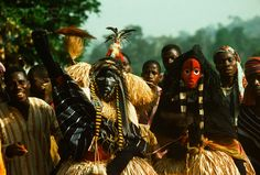 """Africa   People wear a """"Dan"""" mask at the agricultural Festival of Ignames of the Yacouba tribe in Cote d'Ivoire.   Image and caption © Charles & Josette Lenars"""