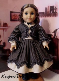 1860's Dress Made to fit American Girl Dolls | Marie-Grace is modeling this Civil War dress made from coordinating printed cottons in black and tan. Bias cut fabric was used to make the ruffles.