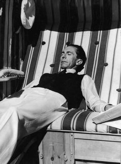 German journalist and Nazi Minister of Propaganda Joseph Goebbels (1897 - 1945) suns himself on an outdoor couch, 1930s. He holds a newspaper in one hand. (Photo by FPG/Getty Images)