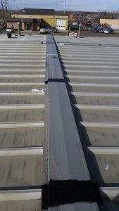 Liquid Rubber to Ridge of Metal Roof (after seam tape).
