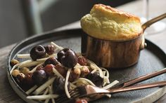 Master the cheese soufflé with this delicious recipe from book 'Milk Made', featuring strong blue cheese and a hard Alpine cheese.This pickled cherry and hazelnut salad really bring this dish into the new age. Pickled Cherries, Cheese Souffle, Cheese Platters, Blue Cheese, Cheese Recipes, Pickles, Cherry, Pudding, Favorite Recipes