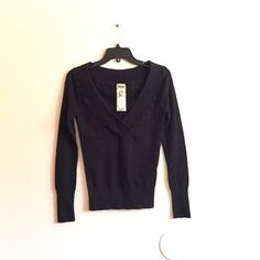 """Sexy V Neck Sweater Top Form fitting black v neck sweater top! Very comfortable material. Only """"damage"""" is a little bit of fading due to wash. Other than that, it's in good condition :) Perfect for fall! #fallfashion #fall #sweater #workattire #work #office #longsleeve Sweaters V-Necks"""