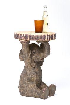 Bijzettafel olifant. Voor de dierenliefhebbers! Deze gave bijzettafel in de vorm van een olifant is echt een te gekke eyecatcher. Je kunt deze bijzettafel bij de bank zetten, als nachtkastje gebruiken, of juist om die plant erop te zetten waar je helemaal happy van wordt. Bijzettafel Olifant komt van het merk Kare Design.
