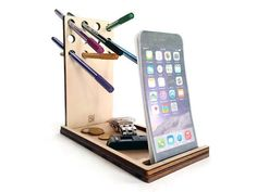 Papp is a laser cut wood phone organizer with desk caddy and pen and pencil stand.  You will be able to always have on hand your smartphone, pens,