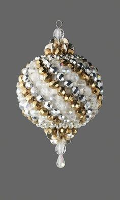 Ornament with Czech Fire-Polished Glass Beads and Silver-Plated Beads by Carol R. Davis. Pretty