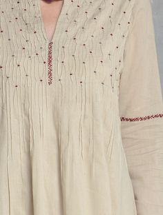 Best 12 Beige Pintuck & Embroidered Cotton Kurta by Radha Embroidery On Kurtis, Kurti Embroidery Design, Hand Embroidery Dress, Embroidered Clothes, Embroidery Fashion, Dress Neck Designs, Sleeve Designs, Blouse Designs, Kurta Patterns