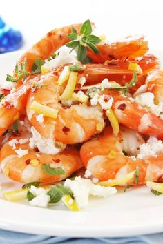 Marinated Shrimp With Mediterranean Salad:1 1⁄2 lb cooked shrimp , peeled and deveined   1⁄4 cup fresh lemon juice   3 tbsp olive oil   1⁄3 cup fresh basil, torn   1⁄4 tsp kosher salt   1 bunch radish, thinly sliced   2 green bell pepper, thinly sliced   1⁄3 cup (3 ounces) black olives, pitted   3 oz feta cheese, sliced   5 oz bag pita chips, or cracker bread   1⁄4 tsp black pepper