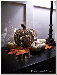 DIY Dollar Store Illuminated Pumpkin http://www.recapturedcharm.com/2011/09/diy-dollar-store-illuminated-pumpkin.html Under $10. That's right! Made entirely from dollar store items, you can reproduce those expensive grapevine wreaths you see at Pier One.