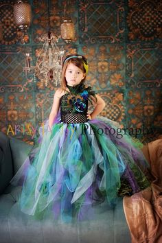 Ava wants to be a peacock for halloween. so this is how to do it, but for $100? I should learn to sew
