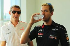 Jenson Button and Sebastian Vettel Photos - Sebastian Vettel (R) of Germany and Infiniti Red Bull Racing talks with Jenson Button (L) of Great Britain and McLaren while they wait to attend the official press conference during previews for the Japanese Formula One Grand Prix at Suzuka Circuit on October 10, 2013 in Suzuka, Japan. - F1 Grand Prix of Japan: Previews