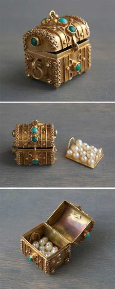 This stunning vintage 1950s 18k yellow gold, Etruscan treasure chest charm, is a wonderful Italian estate find! It is quite intricate, and features turquoise and malachite cabochon stones. It even has removable pearl loot! The time and craftsmanship invested in this piece is incredible. By MintAndMade