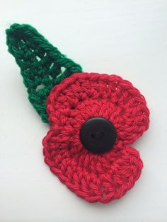 Hand crocheted poppy brooch with leaf - donation to British Legion with purchase by Katiebeesknits on Etsy
