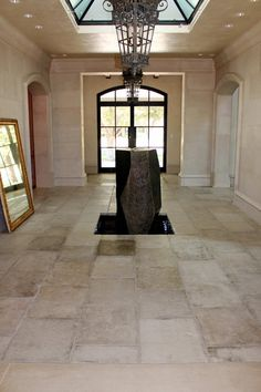 Reclaimed French Limestone Barr gris or grey Barr from France installed as a main anchor piece floor in this grand estate. This antique limestone from the Limestone Rock, Limestone Flooring, Oak Flooring, Floors, Ceiling Materials, French Oak, French Cottage, French Antiques, Terracotta