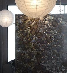Beautiful table top made of tin cans and metal caps #upcycle  This would look great on a mirror as art hanging on the wall.