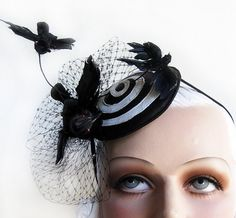 $99.00 ♥ Inspired by The 2 Hitchcock Classics - The Birds & Vertigo  ♥ Buckram & Wire Frame Construction  ♥ Covered in Black & White Leather   ♥ Your Choice - White (shown), Metallic Orange or Metallic Red Swirl