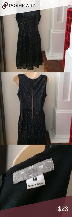 Black sequin cocktail dress Absolutely stunning dress!! Perfect dress to go out in, or to rock a news years eve party!!! Dress fits true to size! I'm selling because I have a higher then normal waist line and it doesn't quite fall right on me :( it has been worn a handful of times, very gentle use, and is in great condition!! issi Dresses Midi