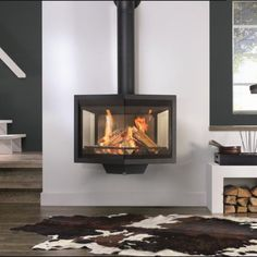 The Black Diamond is an unusually shaped, wall mounted wood burning stove with doors on both sides. A black ceramic top and visibility of the flames from all angles add to the elegance of this stove. Modern Wood Burning Stoves, Log Burning Stoves, Modern Log Burners, Wood Stoves, Wood Wall Design, Freestanding Fireplace, Rustic Wood Walls, Wood Bedroom, Fireplace Design