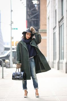 Below-Freezing NYC Street Style That's Still Fire #refinery29  http://www.refinery29.com/2015/02/82279/new-york-fashion-week-2015-street-style-pictures#slide-135  Fuzzy — and functional — fuzzy mittens FTW....