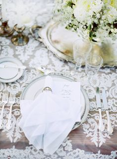 lace overlay on wood table + napkin ring, classic silver tray with centerpiece by @Lisa Vorce with Flowerwild. Photography by: Jose Villa #wedding