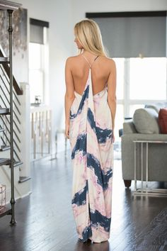 With a gorgeous combination of colors, this unique printed maxi is sure to shine this season! We love the beautiful pairing of navy, lilac, light pink, and cream - it's such a lovely look for spring!