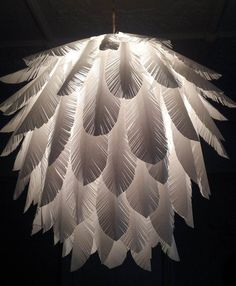 Paper feather hanging light shade. Angelic.