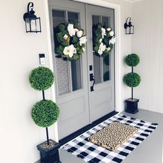 Doors painted in Benjamin Moore Chelsea Gray. Loving this front door/porch for spring! Pier 1 wreaths really add to the overall look. instagram: shelbyhjohnson blog: elementarybysj.wordpress.com