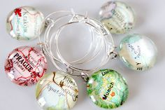 Custom Map Wine Charms 12  Vintage Travel Map Atlas by Dombot, $69.00 - I think I might like these better as necklaces!