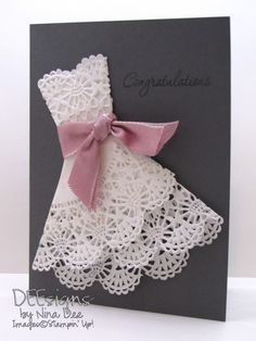DEEsigns by Nina Dee. DEEsigns by Nina Dee See doily fold. Card design for a weeding shows paper doily being folded into a dress formation, a wedding dress.