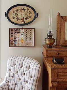 A collection of framed butterflies, via Country Living.