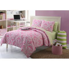 Decorate your daughters room with this pink and green room in a bag. The 11-piece set includes everything you need to spruce up her room. It comes with pillow shams, pillowcases, sheets, a comforter, a dry-erase board, a laundry bag, and an ottoman.