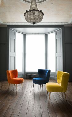 The Duke cocktail chair in zinnia orange, the Fitz cocktail chair in cobalt blue, and the Fitz cocktail chair in primrose yellow. Pick your bold colour.